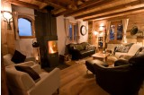 Our cosy lounge with real log fire!